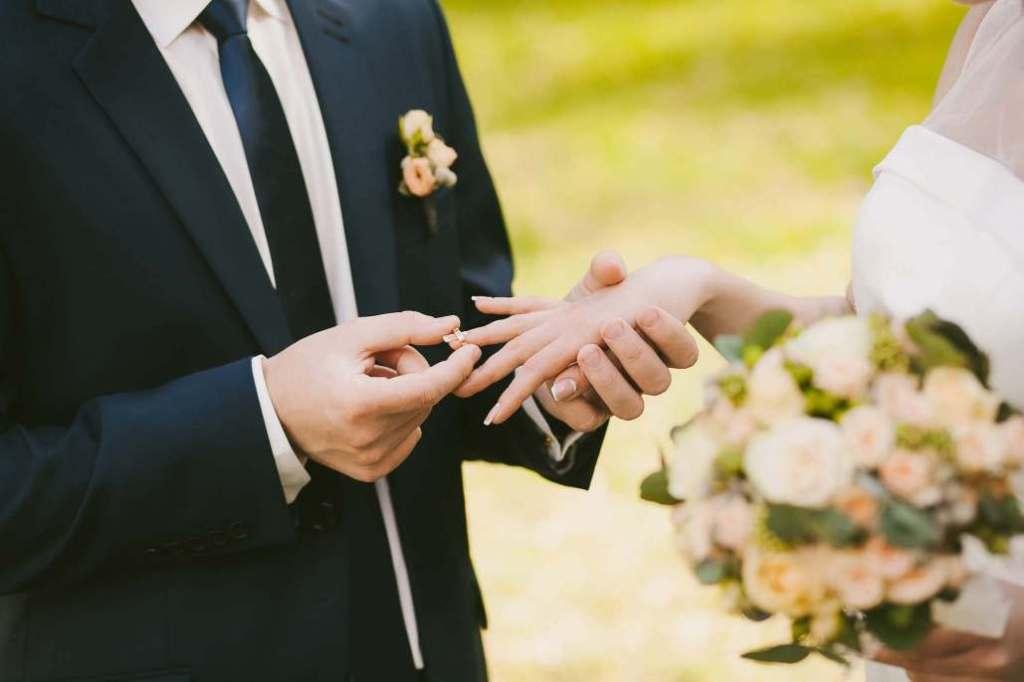 bigstock-Wedding-Rings-And-Hands-Of-Bri